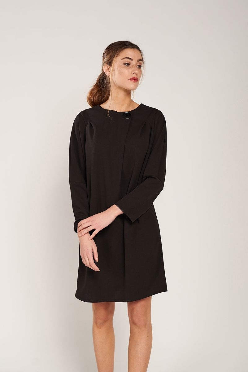 Dress with decorative button